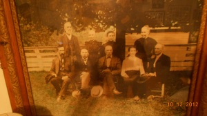 This is a photo of my husband's great grandfather and his siblings.  We think the photo was taken at the passing of one of their parents.