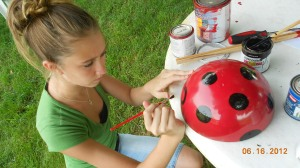 Victoria helping Nana with the artwork.  We started with serious ladybug faces.