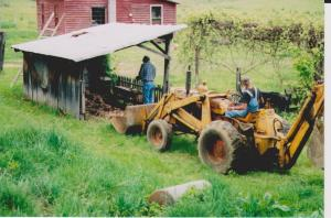 Backhoe is perfect tool for hauling off old brick to fill up ruts or wash outs.