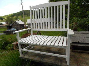 I love wooden rockers but this will make a pretty bench for the porch.  Time to make cushions now.