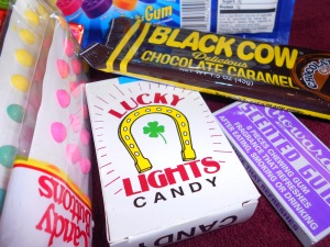 Black Cow (chocolate and caramel) candy cigarettes, Candy buttons