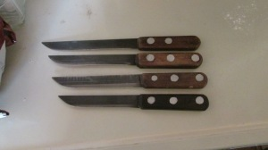 The handles are made from wood he cut at the farm.  The blades were made from steel he had on the farm as well.