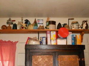 The shelves hold a lot of my antique kitchen items and farm animals (ceramic of course).