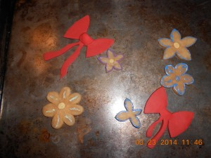 She used polymer clay to make this flowers and bows to attach to some of our projects.
