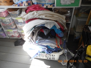 Overloaded laundry basket of ironing.