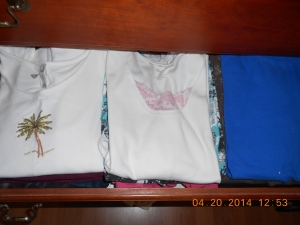 Knit shirts and t-shirts pressed, folded and in the drawers.