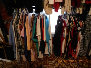Dress clothes pressed and hung ready for wearing to work.
