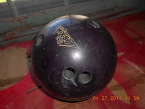 Normal bowling ball with holes to fill.