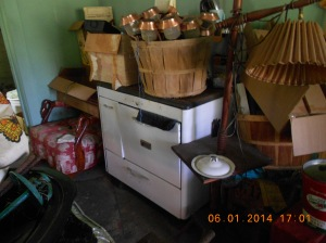 Wood cookstove and chair that has possibilities.