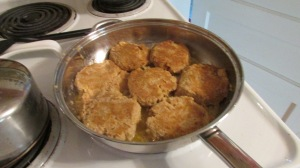Golden brown salmon cakes ready for a hot biscuit and tomato slice!! YUMM!!