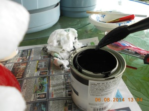 "Black gloss paintm wet paper towel for  ""oops"", newspaper to protect table surface."