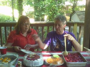 Dessert table at family cookout.  This is my son's fiancée Jennie helping me decide which to take.  We took all!