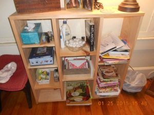 My new bookcase and full of the things I love to work on at night while watching TV together.
