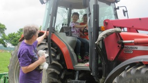 The little girls got to sit in a big tractor.