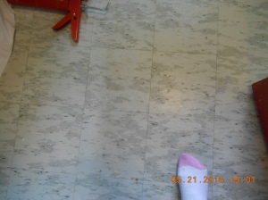Flooring is gray tile and very outdated.