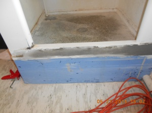 Exterior of the shower walls is being sanded and reinforced for strength and to keep the water in the shower.