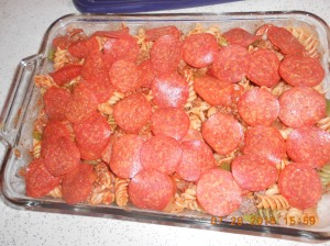 Top it all with pepperoni and then with mozzarella cheese.  Bake at 350* for 30 minutes and cheese is melted and golden.
