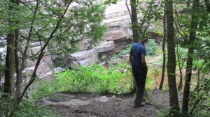 Eddie overlooking the falls and creek below.