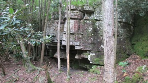 This overhang is used a lot by hikers and visitors. There was a fire pit under the rocks and easy to get under without banging your head.