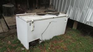 Freezer full of scrap metal.