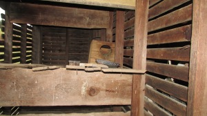 Roscoe's old bed in his new house in the grainery attached to the smokehouse.