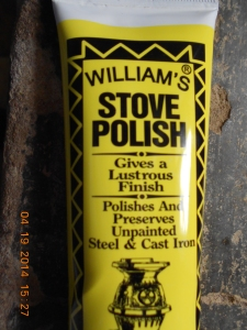 Williams Stove polish goes a long way.  It's odorless and smokeless when the stove is heated.  Great product!!