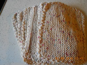 A entire stack of cotton knitted dishcloths.