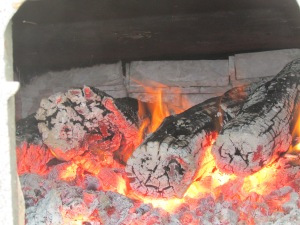 Red hot coals from old locust posts keep things hot and sap boiling from 6:00 am to 9:00 pm.