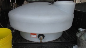 Stock water tank holds 210 gallon at the top ridge of the tank.