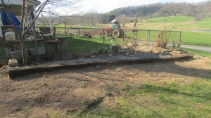 I packed the dirt on the outside perimeter to keep the chickens from scratching it up and to level the ground so I can mow close to it.
