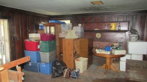 Most of the furniture and boxed treasures were moved to one side of the room.