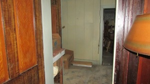 Hallway also leads to the bathroom and the stairwell to the second floor which doesn't have a lot in it but will be cleaned out too.