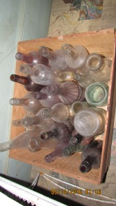 Box after box of bottles, jars, insulators.