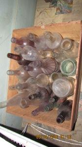 Box after box of bottles, jars, insulators.