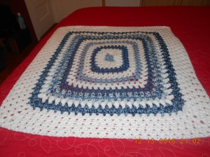 Crocheted coverlet for bed, carseat and floor to play on.