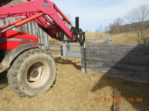 The Massey Ferguson was used to haul in the new fence posts and hauling the pallet of Quikrete.
